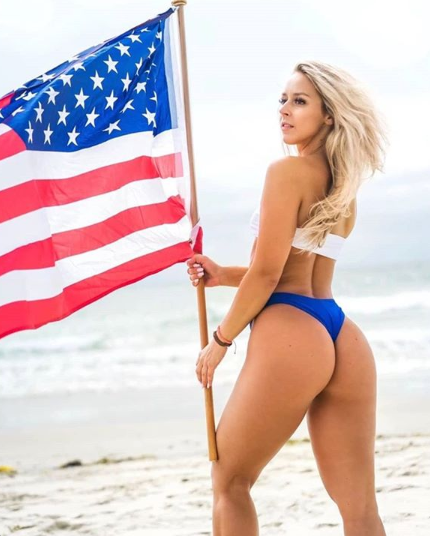 Beautiful woman holding the flag on hump day