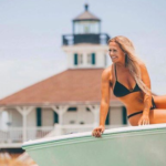 Taylor Harrell smiling on a boat