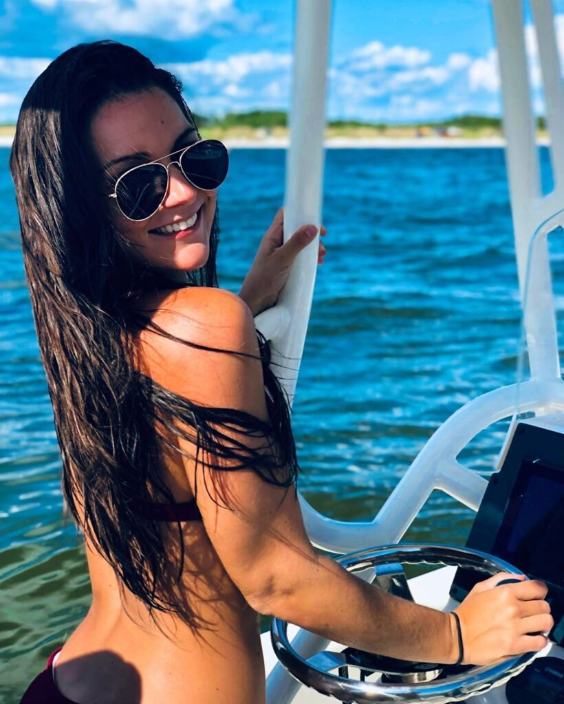 Victoria Valenti driving her boat and looking great!